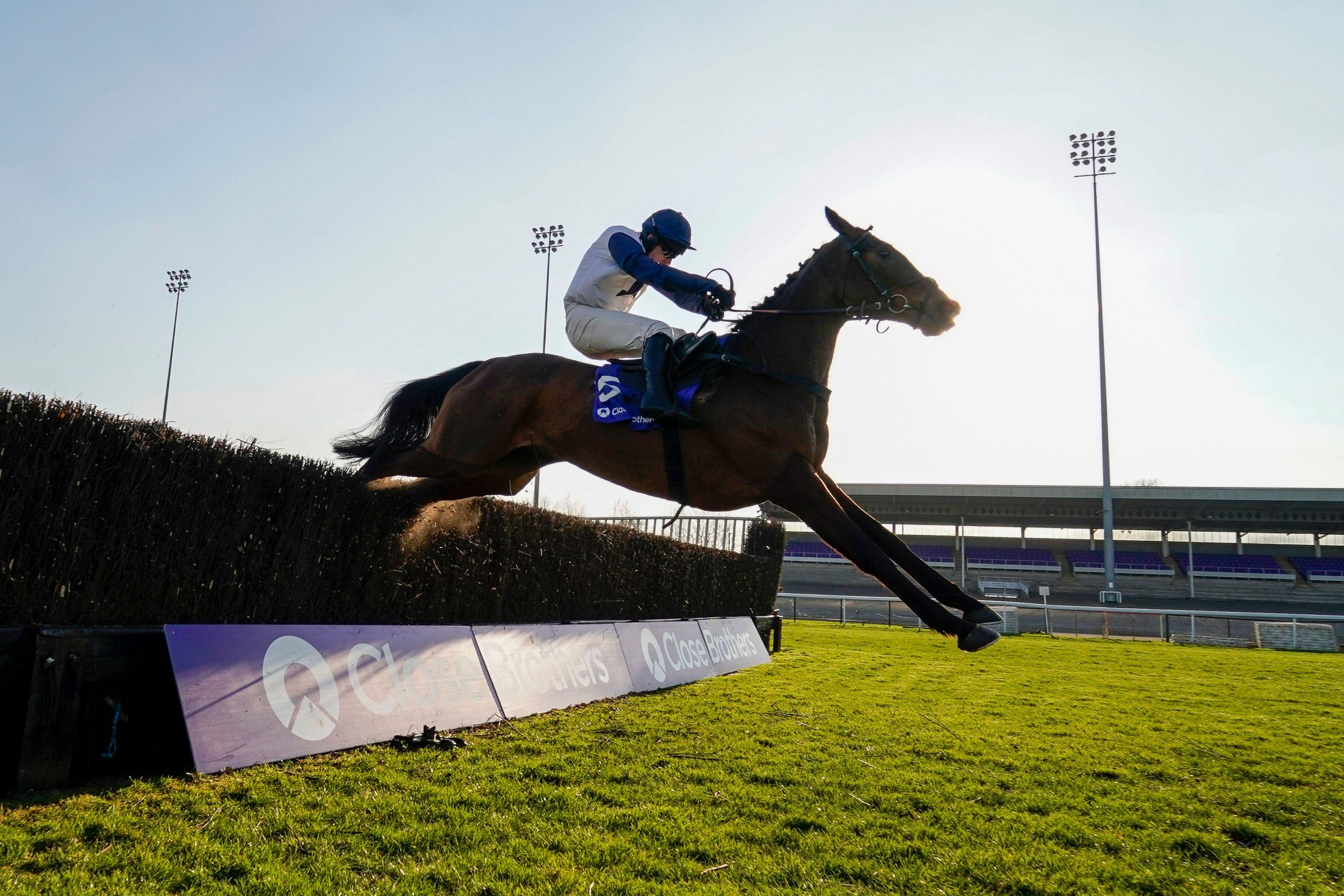 Clondaw Castle ridden by Jonathan Burke clears the last to win The Close Brothers Handicap Chase during the Close Brothers Chase Day at Kempton Park Racecourse. Picture date: Saturday February 27, 2021.