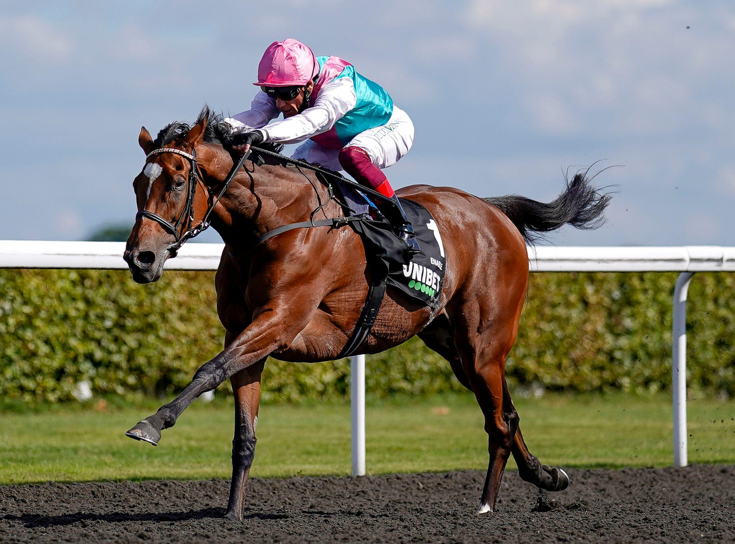 Enable ridden by Frankie Dettori wins The Unibet September Stakes at Kempton Park Racecourse.