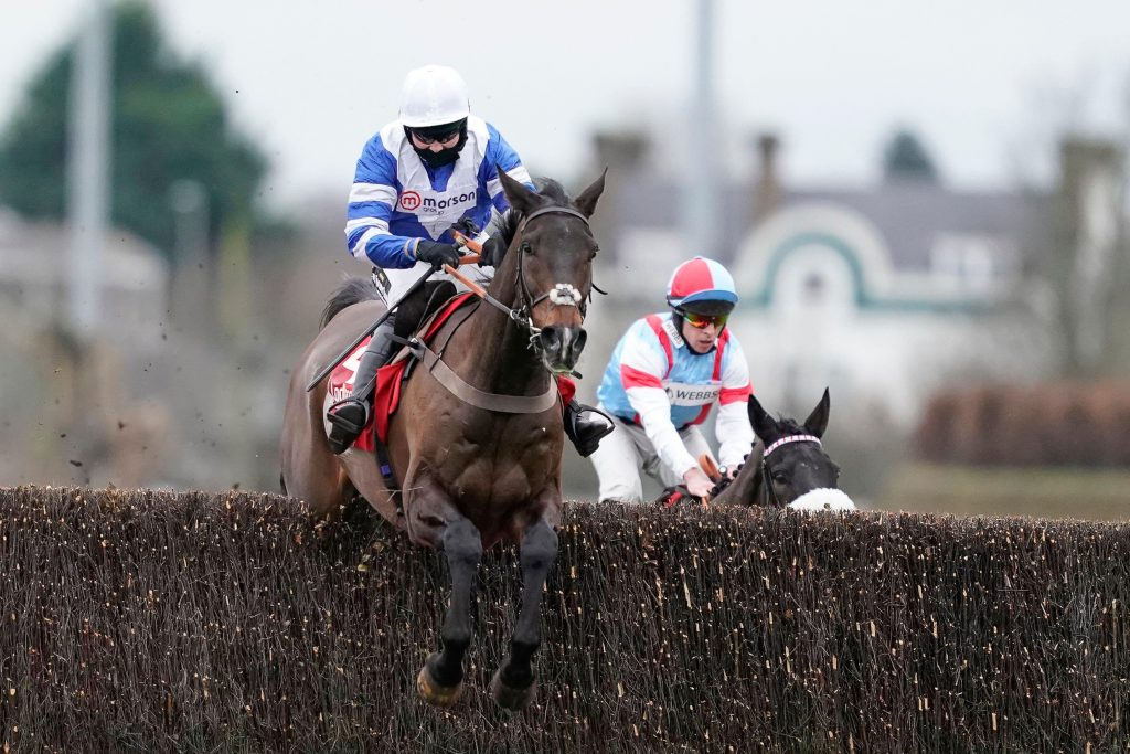 Bryony Frost riding Frodon (left) clear the last to win during King George VI Chase Day of the Ladbrokes Christmas Festival at Kempton Park Racecourse, Sunbury-on-Thames.