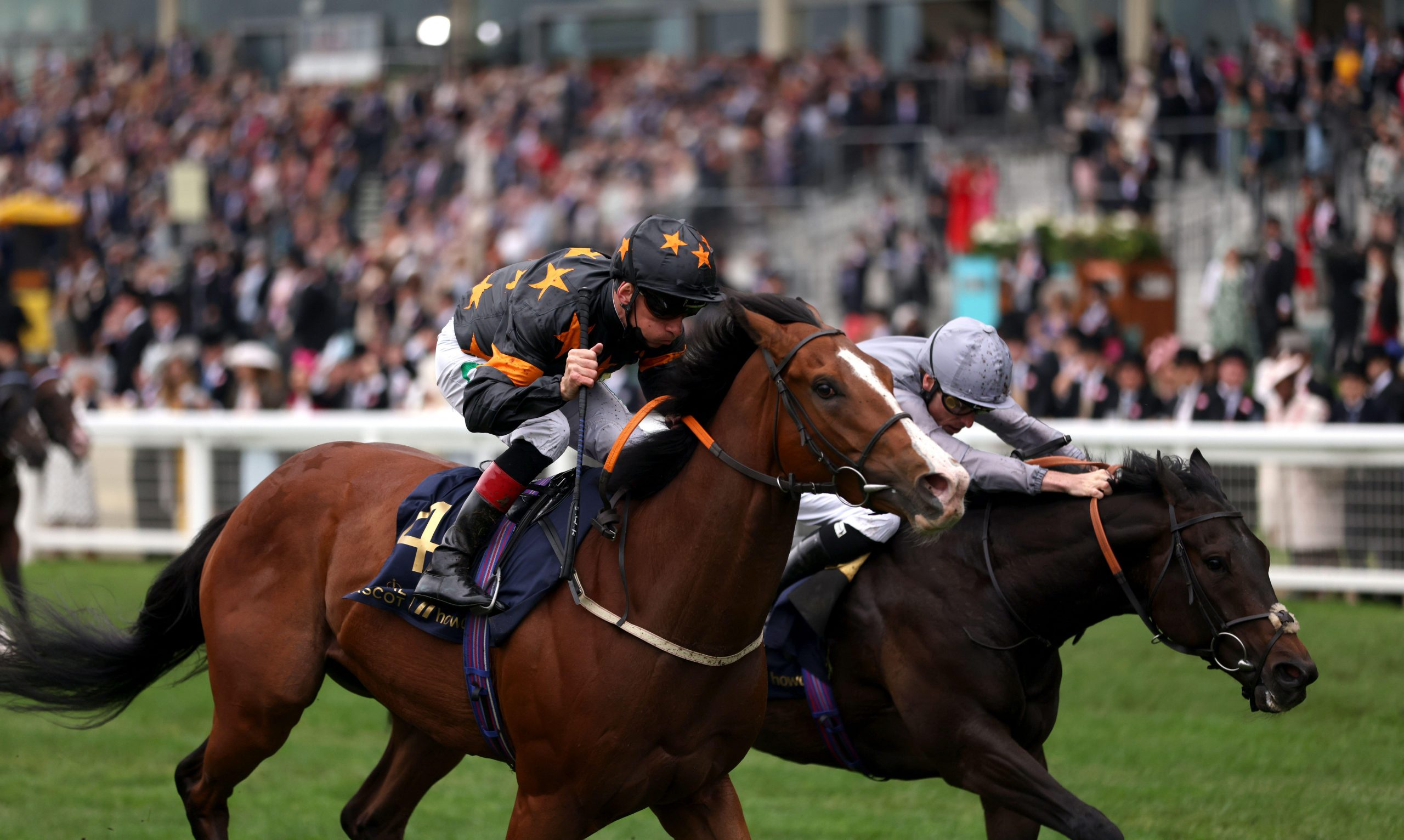 2G47J0D Rohaan (left) ridden by Shane Kelly on their way to winning the Wokingham Stakes, during day five of Royal Ascot at Ascot Racecourse. Picture date: Saturday June 19, 2021.