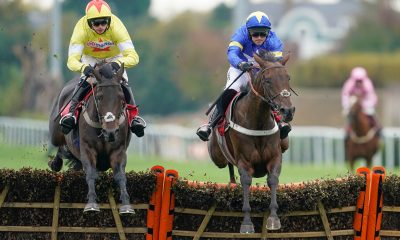 2D6KYWY Mrs Hyde ridden by Nico de Boinville (left) clear the last to win The Racing TV Novices' Hurdle at Kempton Park Racecourse.